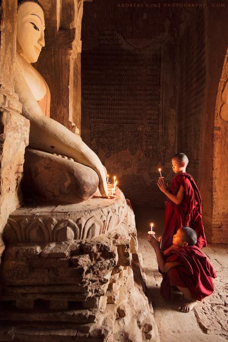novice monks infront of buddha