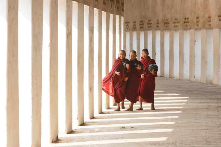 monks-walking-in-white-walkway