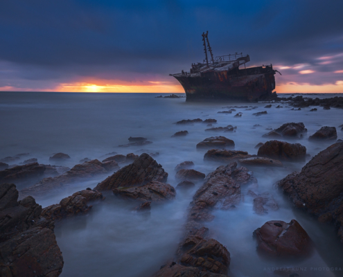 Seascape shipwreck at sunset
