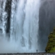 skogafoss-with-men-iceland-