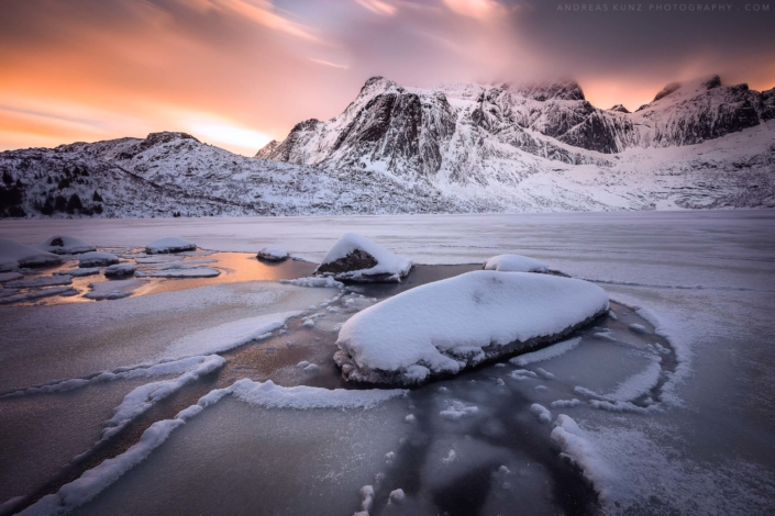 Frozen lake at sunset in Lofoten Norway