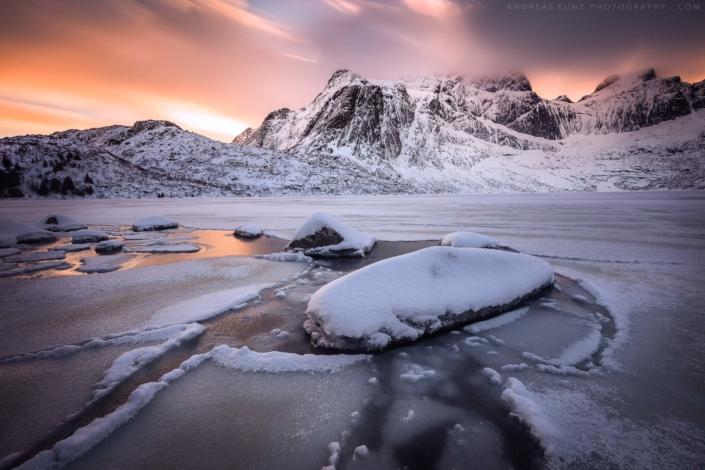 Frozen lake at sunset in Lofoten Norway