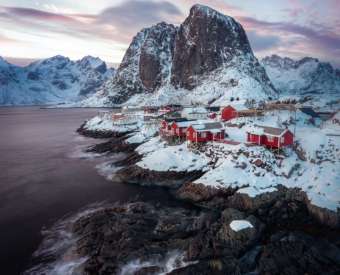 Lofoten Norway with red huts at sunrise